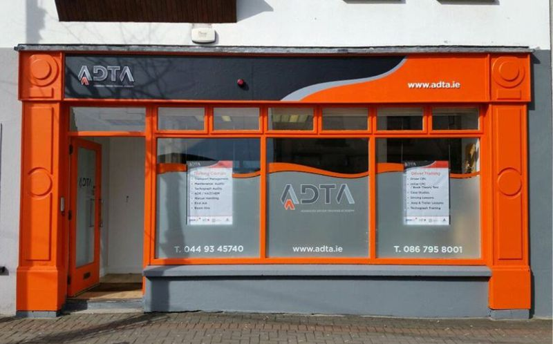 Raised Letters with Printed Graphics and Partial Fascia Wrap - Frosted Window Graphics with Poster Holders and Cut Vinyl Graphics