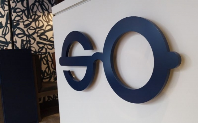 Laser Cut Acrylic Logo with Printed Wall Graphics - Olwell Opticians, Longford