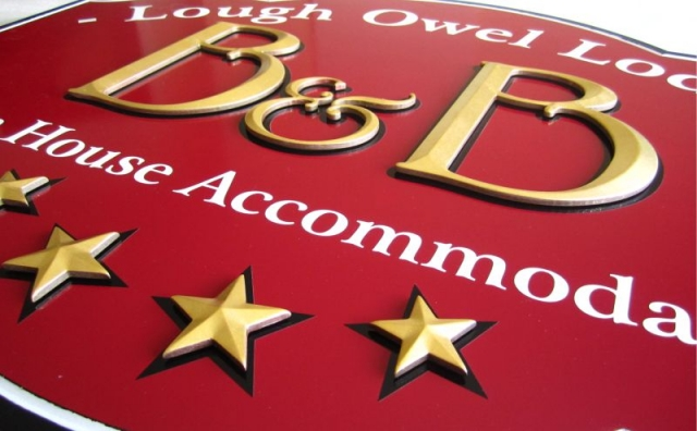 Detail: Gilded Prismatic Raised Letters